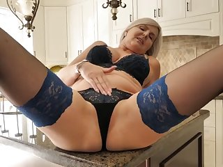 mature mom and wife bating on kitchen