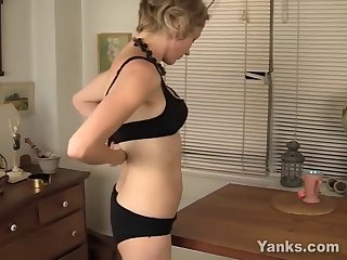 Amateur blonde milf rubs her pussy next to a table