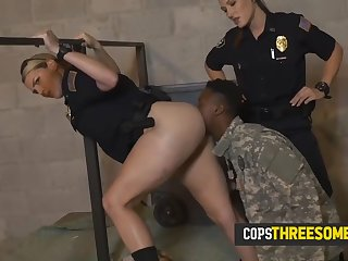 phony soldier is held by milf cop while the other takes his big cock