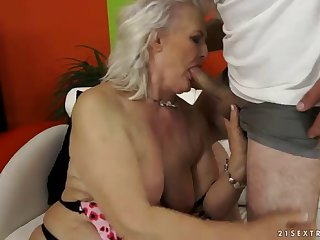 busty granny is fucked silly by a guy with a big cock