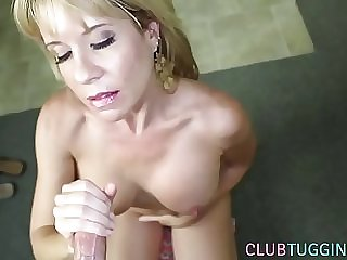 Mature doll tugging on a hard cock