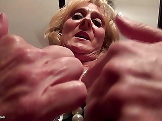 Close-up shooting of mature pussy getting played