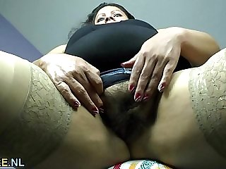 Fat latina mature stripping and spreading legs