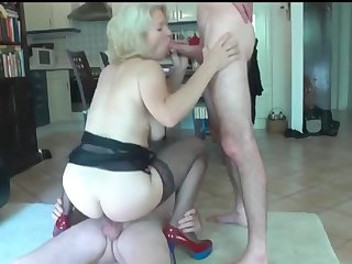 big titted mature still likes to be fucked by two young boys
