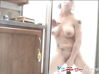 mature blonde slut fucks her pussy with dildo while riding it